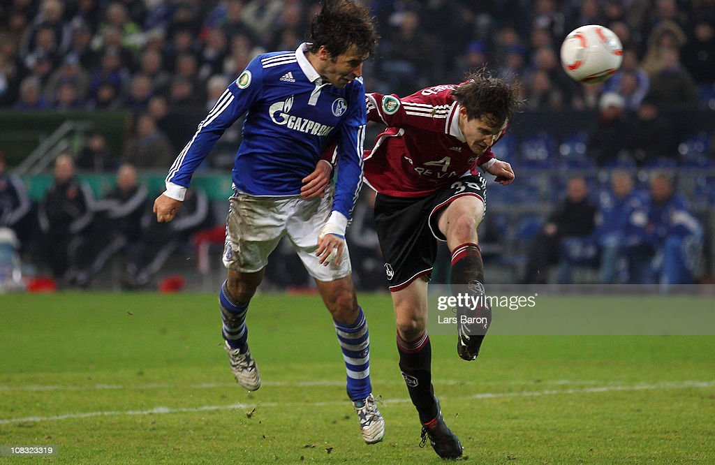 Raul Gonzalez of Schalke goes up for a header with Philipp Wollscheid of Nuernberg during the DFB Cup quarter final match between FC Schalke 04 and 1...