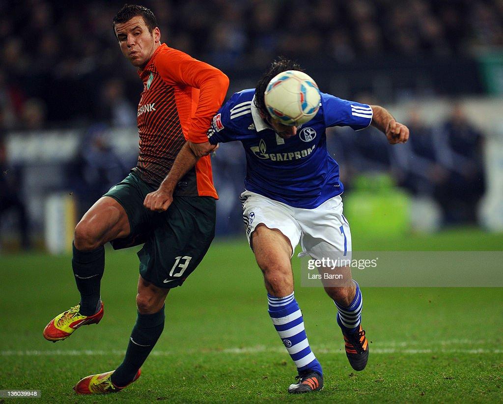 Raul Gonzalez of Schalke heads his teams third goal against Lukas Schmitz of Bremen during the Bundesliga match between FC Schalke 04 and SV Werder...