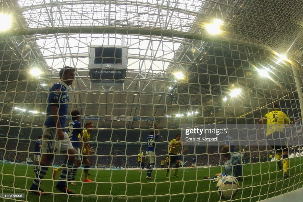 <a gi-track='captionPersonalityLinkClicked' href=/galleries/search?phrase=Raul+Gonzalez+-+Soccer+Player&family=editorial&specificpeople=213309 ng-click='$event.stopPropagation()'>Raul Gonzalez</a> of Schalke (L) looks dejected after getting the second goal of <a gi-track='captionPersonalityLinkClicked' href=/galleries/search?phrase=Sebastian+Kehl&family=editorial&specificpeople=486611 ng-click='$event.stopPropagation()'>Sebastian Kehl</a> of Dortmund (R) during the Bundesliga match between FC Schalke 04 and Borussia Dortmund at Veltins Arena on April 14, 2012 in Gelsenkirchen, Germany.