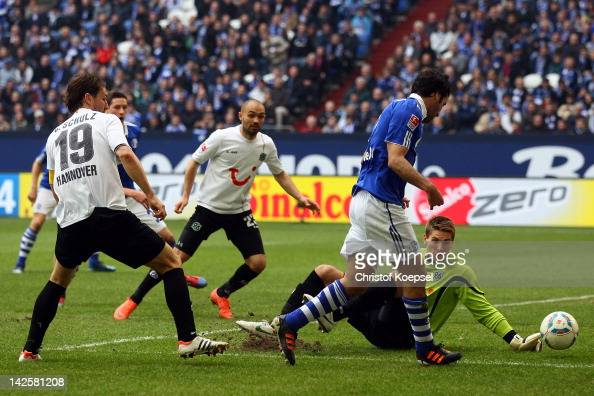Raul Gonzalez of Schalke scores the second goal against RonRobert Zieler of Hannover during the Bundesliga match between FC Schalke 04 and Hanover 96...
