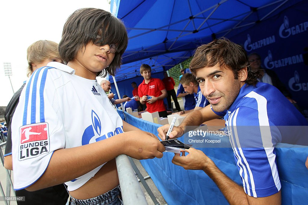 Raul Gonzalez of Schalke writes autographs during the FC Schalke 04 season opening around the Veltins Arena on July 31 2010 in Gelsenkirchen Germany