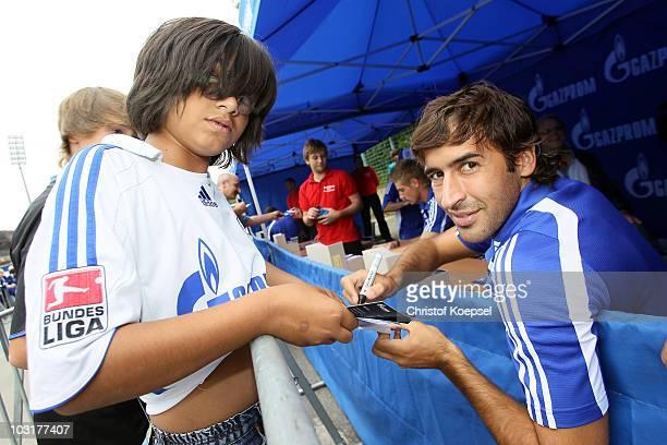 Raul Gonzalez of Schalke writes autographs during the FC Schalke 04 season opening around the Veltins Arena on July 31 2010 in Gelsenkirchen Germany