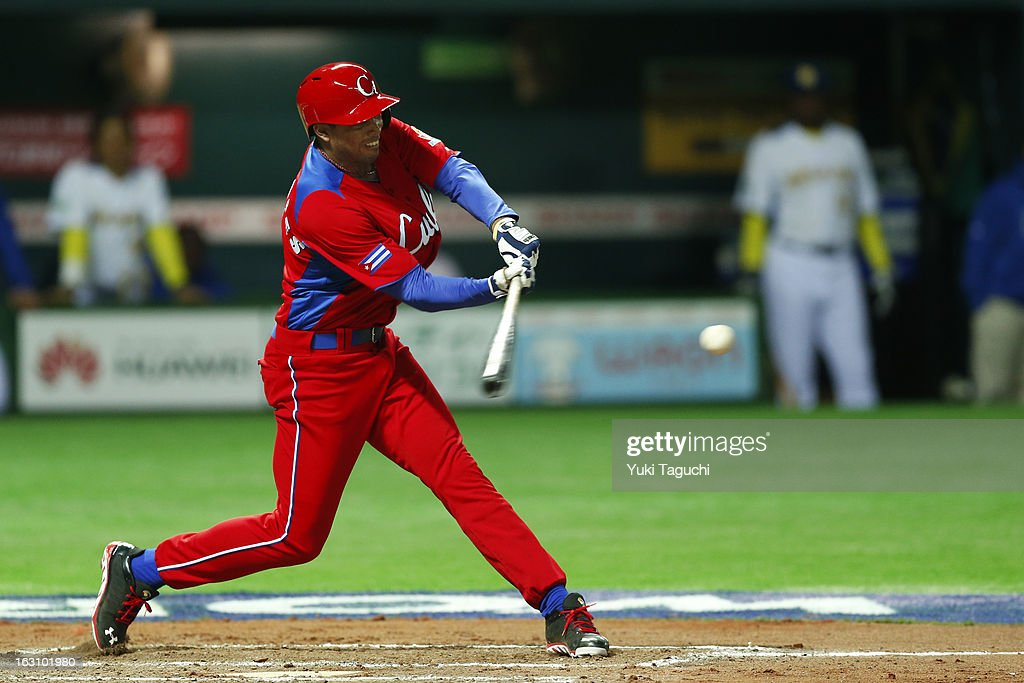 Raul Gonzalez #7 of Team Cuba hits a RBI ground out during Pool A, Game 2 between Team Cuba and Team Brazil during the first round of the 2013 World Baseball Classic at the Fukuoka Yahoo! Japan Dome on Sunday, March 3, 2013 in Fukuoka, Japan.