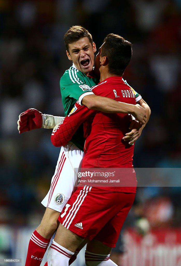 Raul Guding (L) and Alejanro Diaz celebrate scoring during the FIFA U-17 World cup UAE 2013 Quarter final match between Brazil and Mexico at Al Rashid Stadium on November 1, 2013 in Dubai, United Arab Emirates.