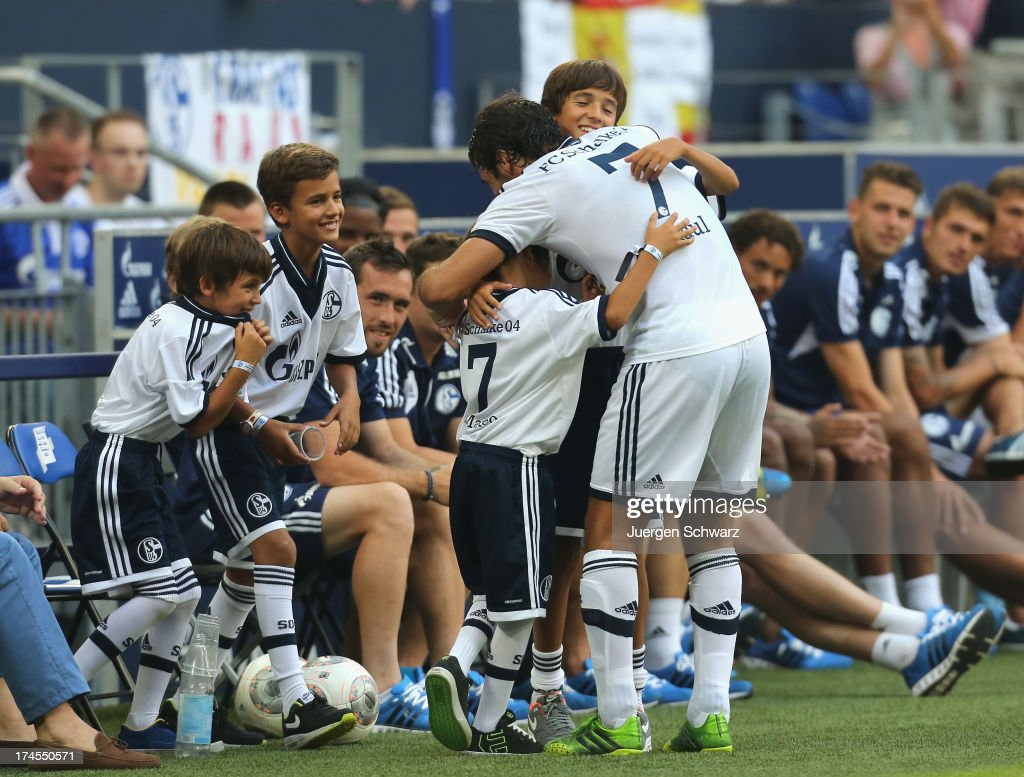 Raul hugs his sons after his farewell match between Schalke 04 and Al-Sadd Sports Club Katar at Veltins Arena on July 27, 2013 in Gelsenkirchen, Germany.