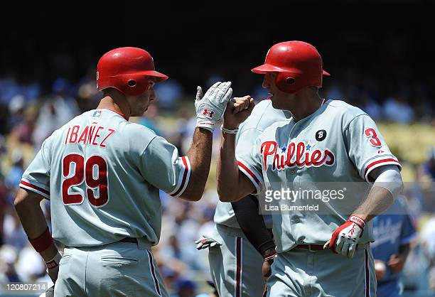 Raul Ibanez congratulates teammate Hunter Pence of the Philadelphia Phillies after hitting a two run homerun in the fourth inning against the Los...