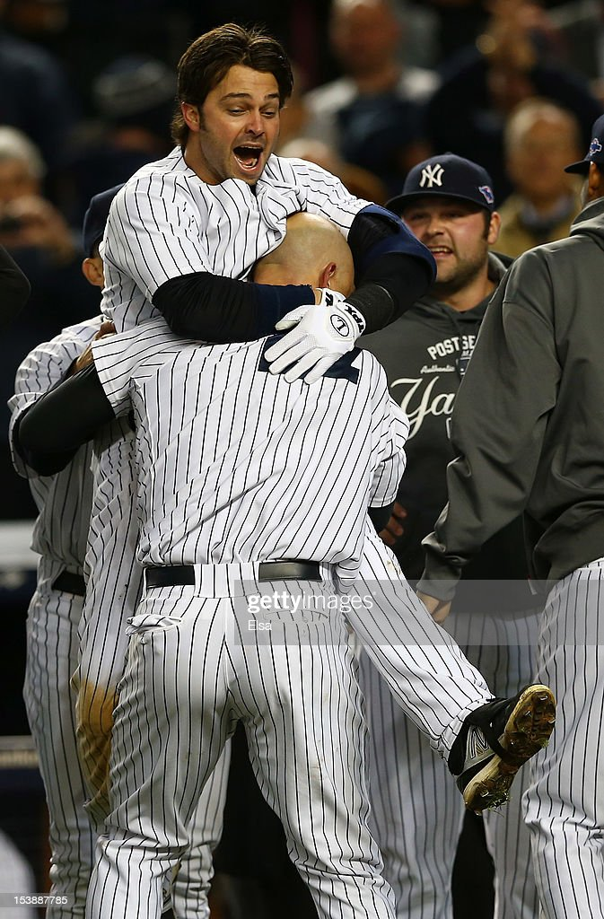 Raul Ibanez #27 of the New York Yankees celebrates a walk off home run in the bottom of the twelfth inning with teammate <a gi-track='captionPersonalityLinkClicked' href=/galleries/search?phrase=Nick+Swisher&family=editorial&specificpeople=206417 ng-click='$event.stopPropagation()'>Nick Swisher</a> #33 after defeating the Baltimore Orioles in Game Three of the American League Division Series at Yankee Stadium on October 10, 2012 in the Bronx borough of New York City.