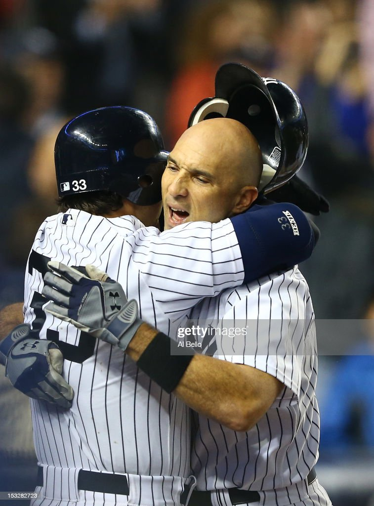 <a gi-track='captionPersonalityLinkClicked' href=/galleries/search?phrase=Raul+Ibanez&family=editorial&specificpeople=206118 ng-click='$event.stopPropagation()'>Raul Ibanez</a> #27 of the New York Yankees celebrates his game tying home run with <a gi-track='captionPersonalityLinkClicked' href=/galleries/search?phrase=Nick+Swisher&family=editorial&specificpeople=206417 ng-click='$event.stopPropagation()'>Nick Swisher</a> #33 against the Boston Red Sox during their game on October 2, 2012 at Yankee Stadium in the Bronx borough of New York City