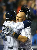 Raul Ibanez of the New York Yankees celebrates his game tying home run with Nick Swisher against the Boston Red Sox during their game on October 2...