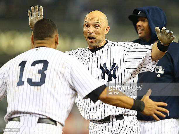 Raul Ibanez of the New York Yankees celebrates with Alex Rodriguez after hitting a walkoff single against the Boston Red Sox in the twelfth inning to...