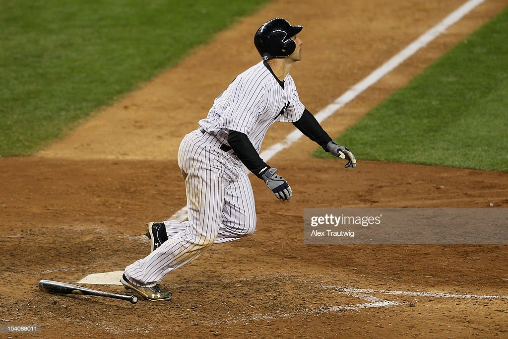<a gi-track='captionPersonalityLinkClicked' href=/galleries/search?phrase=Raul+Ibanez&family=editorial&specificpeople=206118 ng-click='$event.stopPropagation()'>Raul Ibanez</a> #27 of the New York Yankees hits a 2-run home run in the bottom of the ninth inning againt the Detroit Tigers during Game One of the American League Championship Series at Yankee Stadium on October 13, 2012 in the Bronx borough of New York City, New York.