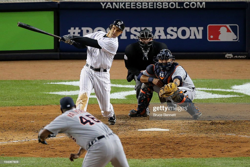 <a gi-track='captionPersonalityLinkClicked' href=/galleries/search?phrase=Raul+Ibanez&family=editorial&specificpeople=206118 ng-click='$event.stopPropagation()'>Raul Ibanez</a> #27 of the New York Yankees hits a 2-run home run in the bottom the ninth inning off of <a gi-track='captionPersonalityLinkClicked' href=/galleries/search?phrase=Jose+Valverde&family=editorial&specificpeople=689773 ng-click='$event.stopPropagation()'>Jose Valverde</a> #46 of the Detroit Tigers during Game One of the American League Championship Series at Yankee Stadium on October 13, 2012 in the Bronx borough of New York City, New York.
