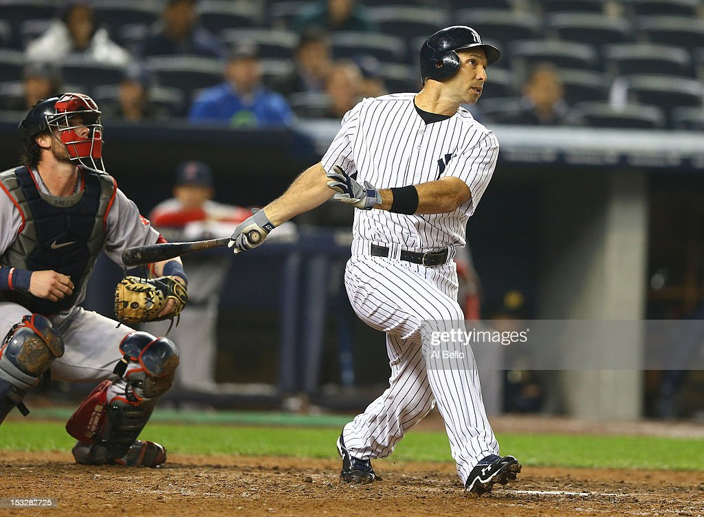 Raul Ibanez #27 of the New York Yankees hits a game tying home run against the Boston Red Sox during their game on October 2, 2012 at Yankee Stadium in the Bronx borough of New York City