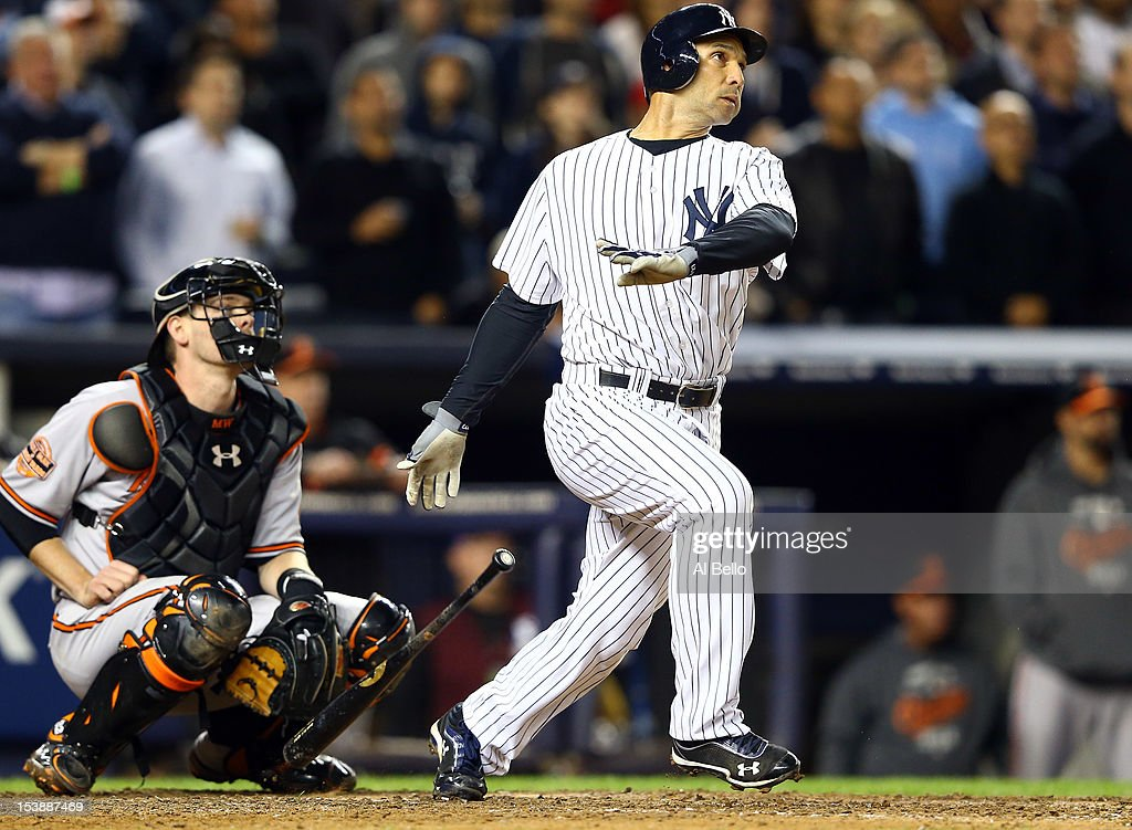 Raul Ibanez #27 of the New York Yankees hits a solo home run in the bottom of the ninth inning to tie Game Three of the American League Division Series against the Baltimore Orioles at Yankee Stadium on October 10, 2012 in the Bronx borough of New York City.