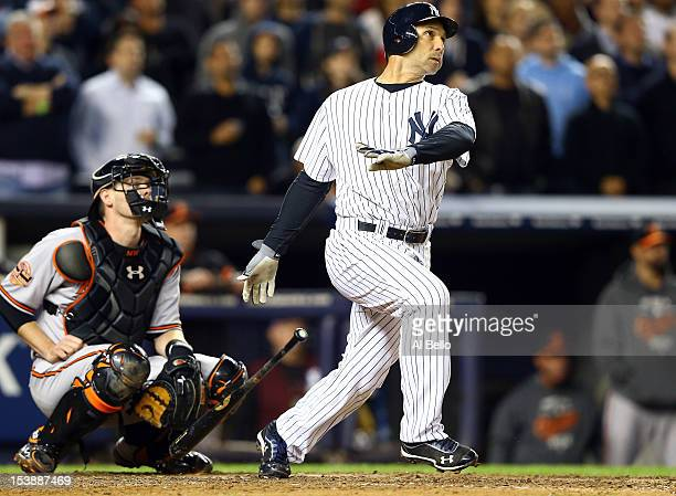 Raul Ibanez of the New York Yankees hits a solo home run in the bottom of the ninth inning to tie Game Three of the American League Division Series...
