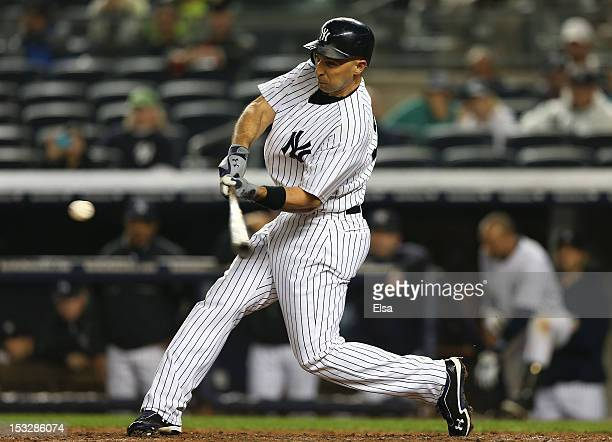 Raul Ibanez of the New York Yankees hits a two run homer in the bottom of the ninth inning against the Boston Red Sox on October 2 2012 at Yankee...