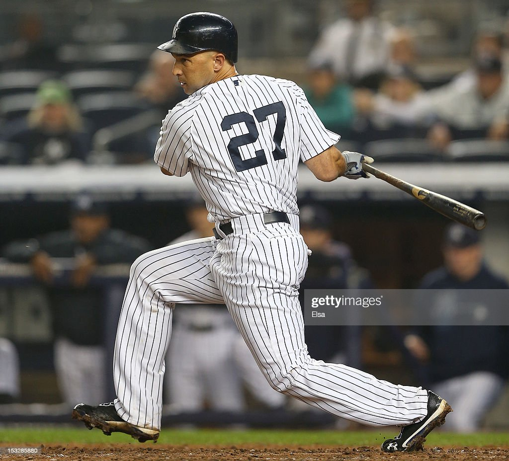 <a gi-track='captionPersonalityLinkClicked' href=/galleries/search?phrase=Raul+Ibanez&family=editorial&specificpeople=206118 ng-click='$event.stopPropagation()'>Raul Ibanez</a> #27 of the New York Yankees hits an RBI in the bottom of the 12th inning against the Boston Red Sox to win the game on October 2, 2012 at Yankee Stadium in the Bronx borough of New York City. The New York Yankees defeated the Boston Red Sox 4-3 in 12 innings.