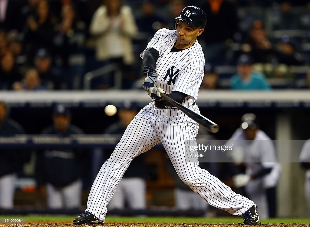Raul Ibanez #27 of the New York Yankees hits an RBI single in the fifth inning against the Baltimore Orioles during Game Five of the American League Division Series at Yankee Stadium on October 12, 2012 in New York, New York.