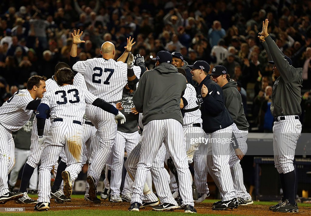 Raul Ibanez #27 of the New York Yankees reacts after hitting a walk off home run in the bottom of the twelfth inning to defeat the Baltimore Orioles in Game Three of the American League Division Series at Yankee Stadium on October 10, 2012 in the Bronx borough of New York City.