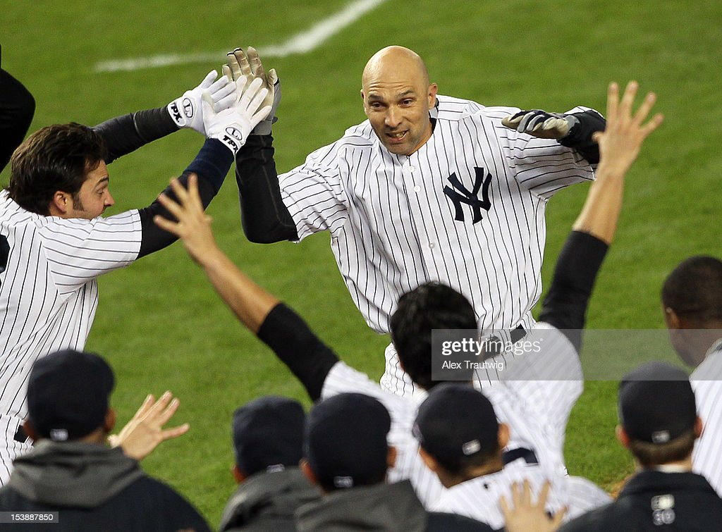 <a gi-track='captionPersonalityLinkClicked' href=/galleries/search?phrase=Raul+Ibanez&family=editorial&specificpeople=206118 ng-click='$event.stopPropagation()'>Raul Ibanez</a> #27 of the New York Yankees reacts after hitting a walk off home run in the bottom of the twelfth inning to defeat the Baltimore Orioles in Game Three of the American League Division Series at Yankee Stadium on October 10, 2012 in the Bronx borough of New York City.
