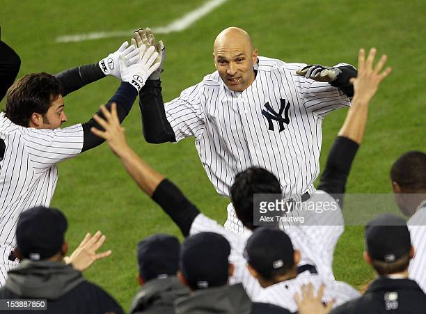 Raul Ibanez of the New York Yankees reacts after hitting a walk off home run in the bottom of the twelfth inning to defeat the Baltimore Orioles in...