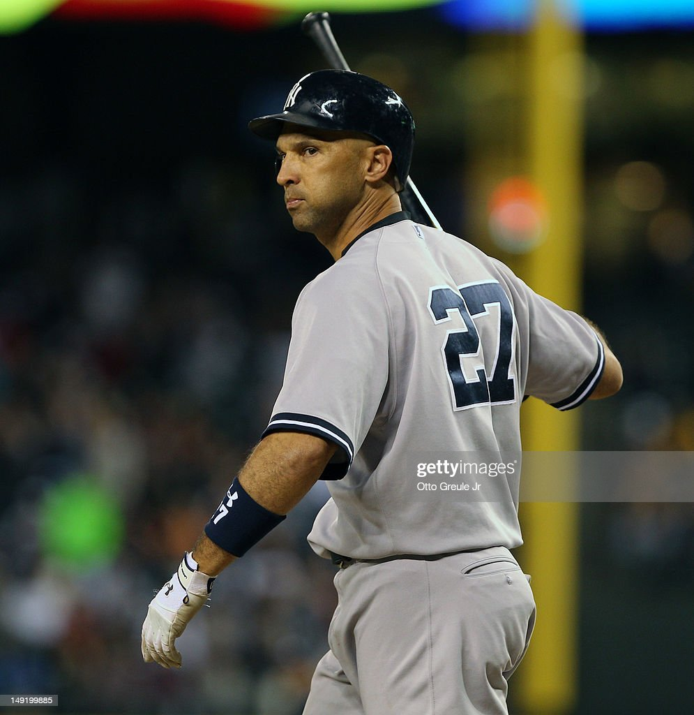 Raul Ibanez #27 of the New York Yankees tosses his bat away after striking out to end the eighth inning against the Seattle Mariners at Safeco Field on July 24, 2012 in Seattle, Washington. The Mariners defeated the Yankees 4-2.