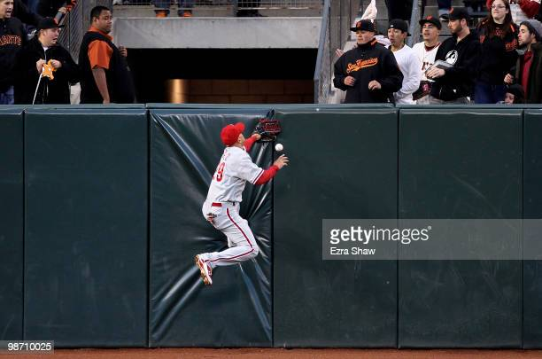 Raul Ibanez of the Philadelphia Phillies can't catch a ball hit by Nate Schierholtz of the San Francisco Giants at ATT Park on April 27 2010 in San...