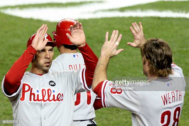 Raul Ibanez of the Philadelphia Phillies celebrates after scoring in the second inning on an RBI double by Matt Stairs with teammate Jayson Werth...