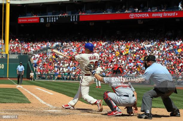 Raul Ibanez of the Philadelphia Phillies connects on a fifth inning home run against the St Louis Cardinals at Citizens Bank Park on May 6 2010 in...