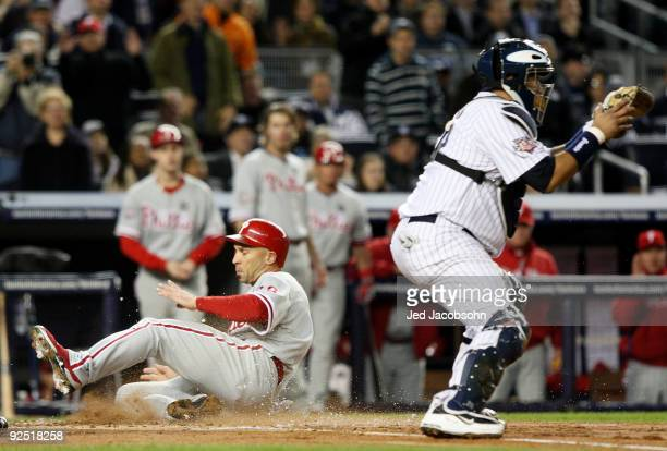 Raul Ibanez of the Philadelphia Phillies scores a run in the second inning on an RBI double by Matt Stairs against the New York Yankees in Game Two...