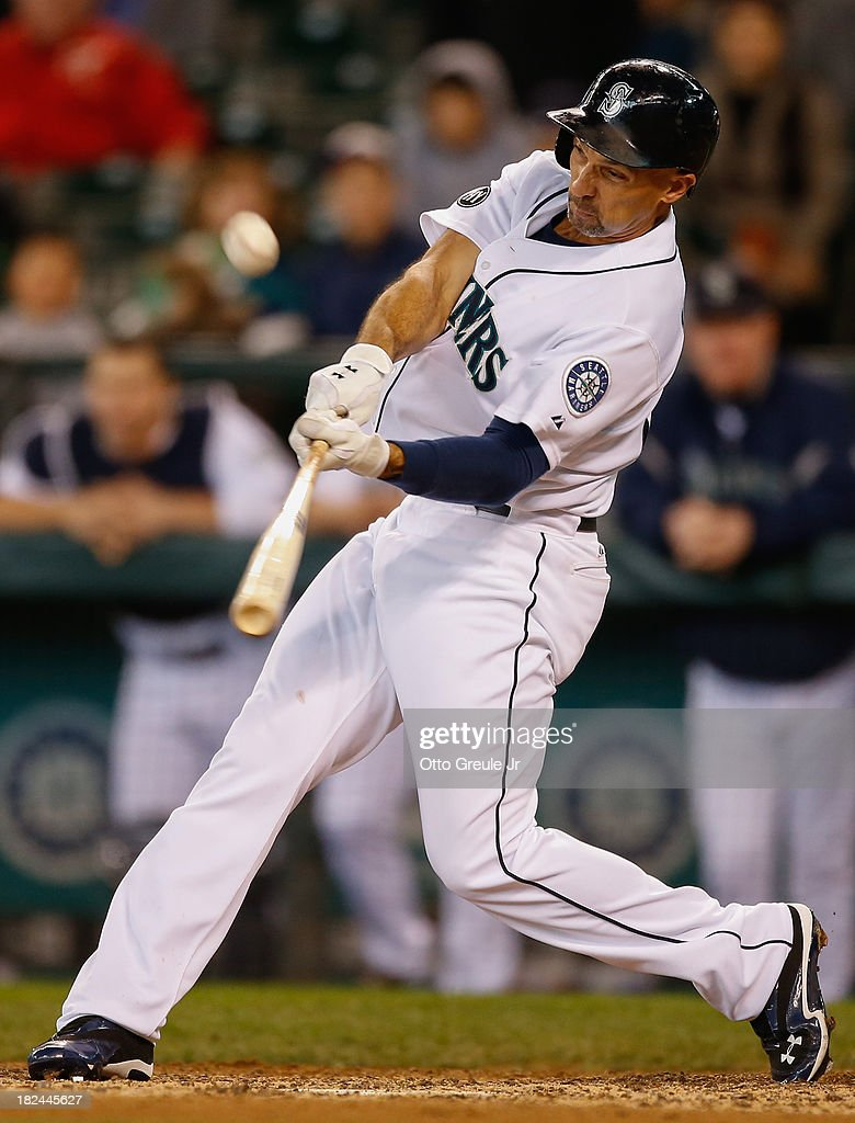 <a gi-track='captionPersonalityLinkClicked' href=/galleries/search?phrase=Raul+Ibanez&family=editorial&specificpeople=206118 ng-click='$event.stopPropagation()'>Raul Ibanez</a> #28 of the Seattle Mariners flies out in his final at-bat of the regular season against the Oakland Athletics at Safeco Field on September 29, 2013 in Seattle, Washington. The Athletics defeated the Mariners 9-0.