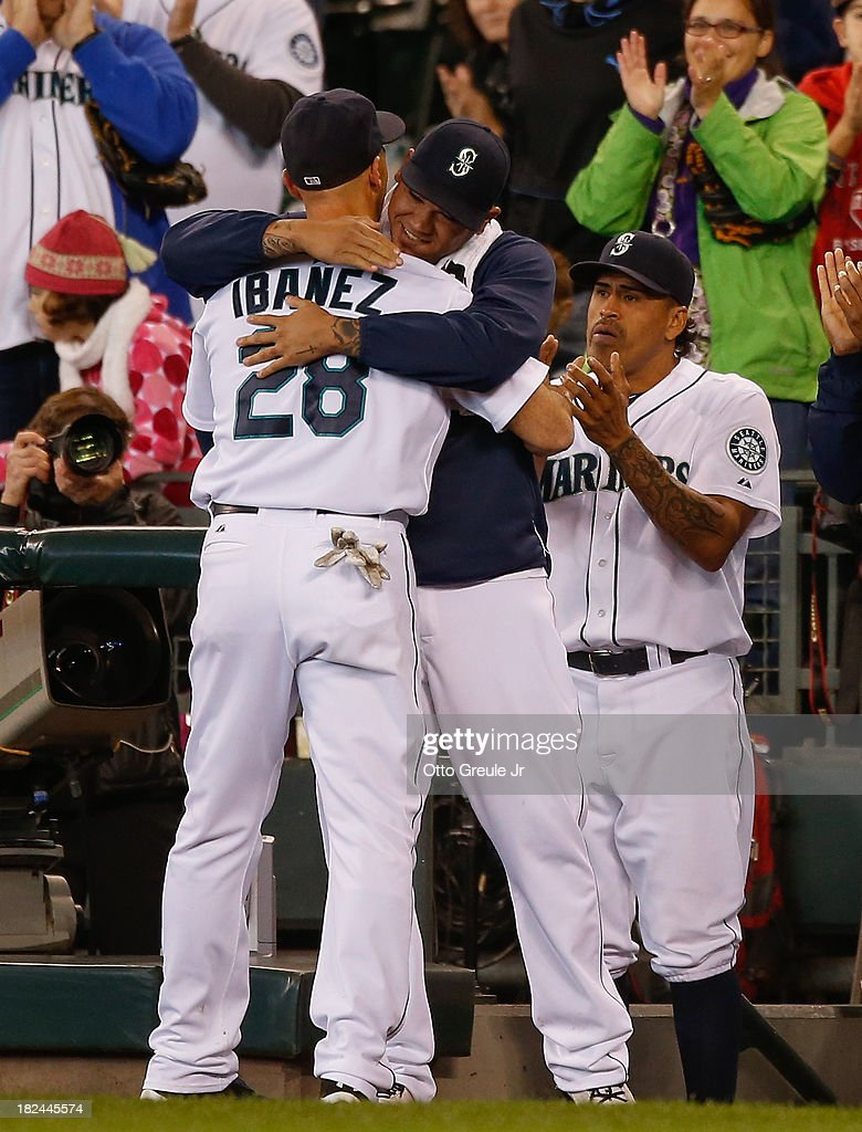 <a gi-track='captionPersonalityLinkClicked' href=/galleries/search?phrase=Raul+Ibanez&family=editorial&specificpeople=206118 ng-click='$event.stopPropagation()'>Raul Ibanez</a> #28 of the Seattle Mariners gets a hug from pitcher <a gi-track='captionPersonalityLinkClicked' href=/galleries/search?phrase=Felix+Hernandez&family=editorial&specificpeople=550749 ng-click='$event.stopPropagation()'>Felix Hernandez</a> #34 as he is removed from the game in the ninth inning against the Oakland Athletics at Safeco Field on September 29, 2013 in Seattle, Washington. The Athletics defeated the Mariners 9-0.
