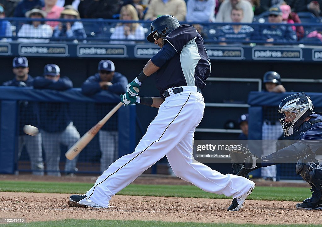 <a gi-track='captionPersonalityLinkClicked' href=/galleries/search?phrase=Raul+Ibanez&family=editorial&specificpeople=206118 ng-click='$event.stopPropagation()'>Raul Ibanez</a> #28 of the Seattle Mariners hits a fly ball to center against the San Diego Padres in the spring training at Peoria Sports Complex on February 23, 2013 in Peoria, Arizona.