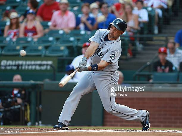 Raul Ibanez of the Seattle Mariners hits a home run in the first inning against the Texas Rangers at Rangers Ballpark in Arlington on July 2 2013 in...