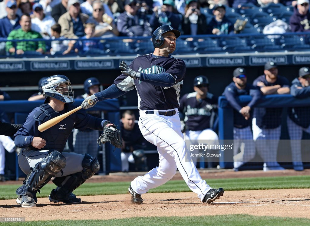 <a gi-track='captionPersonalityLinkClicked' href=/galleries/search?phrase=Raul+Ibanez&family=editorial&specificpeople=206118 ng-click='$event.stopPropagation()'>Raul Ibanez</a> #28 of the Seattle Mariners hits a three run home run against the San Diego Padres in the first inning during the spring training game at Peoria Sports Complex on February 24, 2013 in Peoria, Arizona.