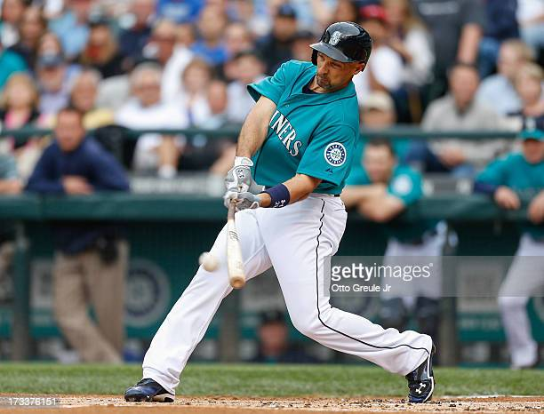 Raul Ibanez of the Seattle Mariners hits an RBI double in the first inning against the Los Angeles Angels of Anaheim at Safeco Field on July 12 2013...