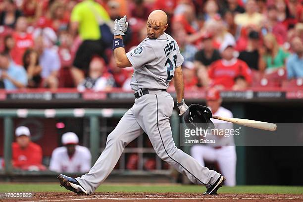 Raul Ibanez of the Seattle Mariners loses his helmet after a swing and a miss in the third inning against the Cincinnati Reds at Great American Ball...