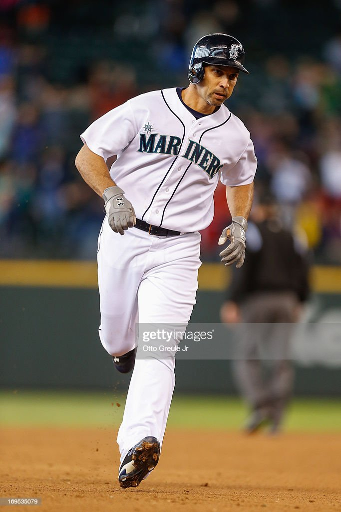 Raul Ibanez #28 of the Seattle Mariners rounds the bases after hitting a game-tying home run against the Texas Rangers in the eleventh inning at Safeco Field on May 26, 2013 in Seattle, Washington.