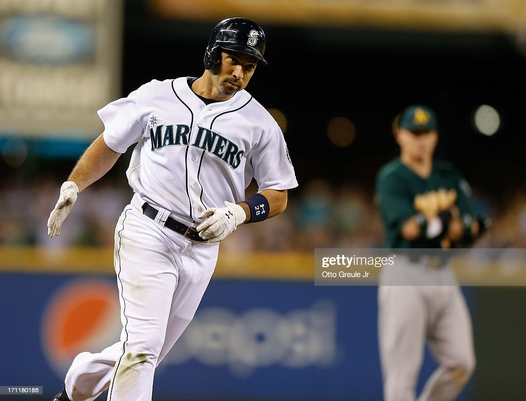 Raul Ibanez #28 of the Seattle Mariners rounds the bases after hitting a three-run homer in the seventh inning against the Oakland Athletics at Safeco Field on June 22, 2013 in Seattle, Washington.
