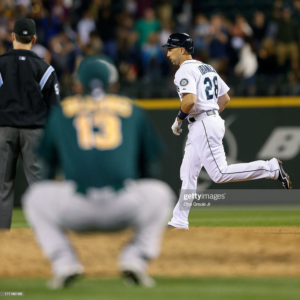 Raul Ibanez #28 of the Seattle Mariners rounds the bases after hitting a three-run homer in the seventh inning off of relief pitcher Jerry Blevins #13 of the Oakland Athletics at Safeco Field on June 22, 2013 in Seattle, Washington.
