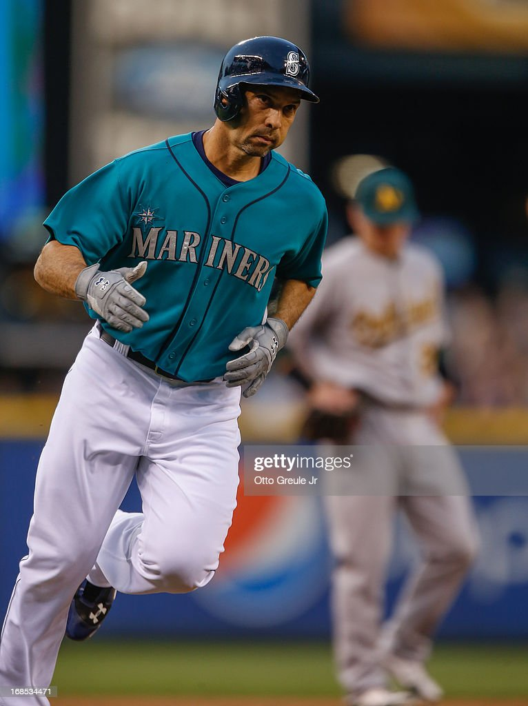 <a gi-track='captionPersonalityLinkClicked' href=/galleries/search?phrase=Raul+Ibanez&family=editorial&specificpeople=206118 ng-click='$event.stopPropagation()'>Raul Ibanez</a> #28 of the Seattle Mariners rounds third base after hitting a three-run home run in the third inning against the Oakland Athletics at Safeco Field on May 10, 2013 in Seattle, Washington.