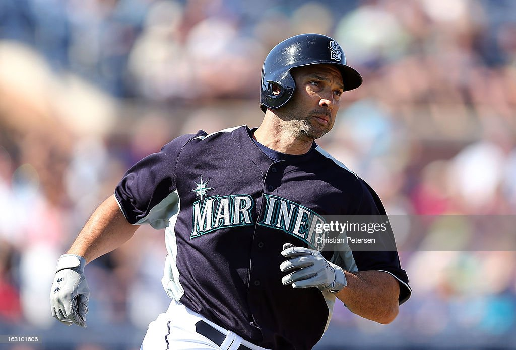 <a gi-track='captionPersonalityLinkClicked' href=/galleries/search?phrase=Raul+Ibanez&family=editorial&specificpeople=206118 ng-click='$event.stopPropagation()'>Raul Ibanez</a> #28 of the Seattle Mariners runs the bases after hitting a solo home run against the Colorado Rockies during the third inning of the spring training game at Peoria Stadium on March 4, 2013 in Peoria, Arizona.
