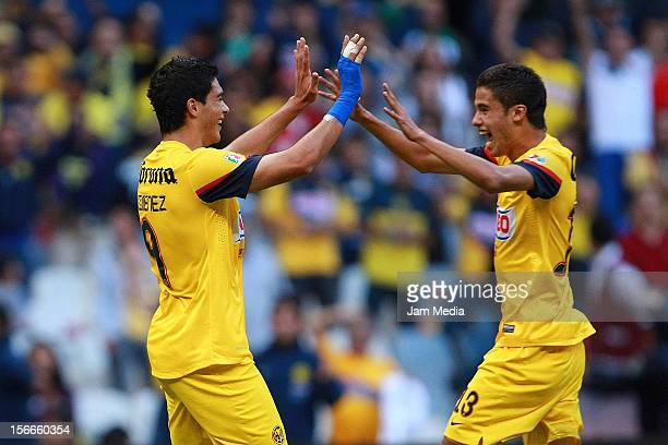 Raul Jimenez and Diego Reyes of America celebrate a scored goal against Morelia during a match between America and Morelia as part of the Apertura...