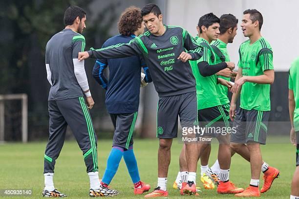Raul Jimenez jokes with Jesus Corona during a training session of Mexico at Estadio O' Rei Pele Training Center on June 20 2014 in Santos Brazil...