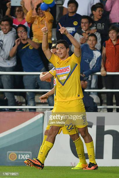 Raul Jimenez of America celebrates a scored a goal against Pachuca during the Apertura 2013 Liga Bancomer MX at Hidalgo Stadium on August 17 2013 in...