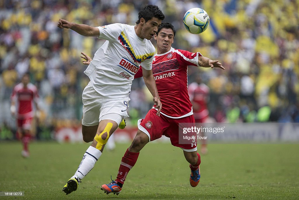 Raul Jimenez of America fights for the ball with Fausto Pinto of Toluca during a Clausura 2013 Liga MX match between America and Toluca at Azteca Stadium on February 16, 2013 in Mexico City, Mexico.