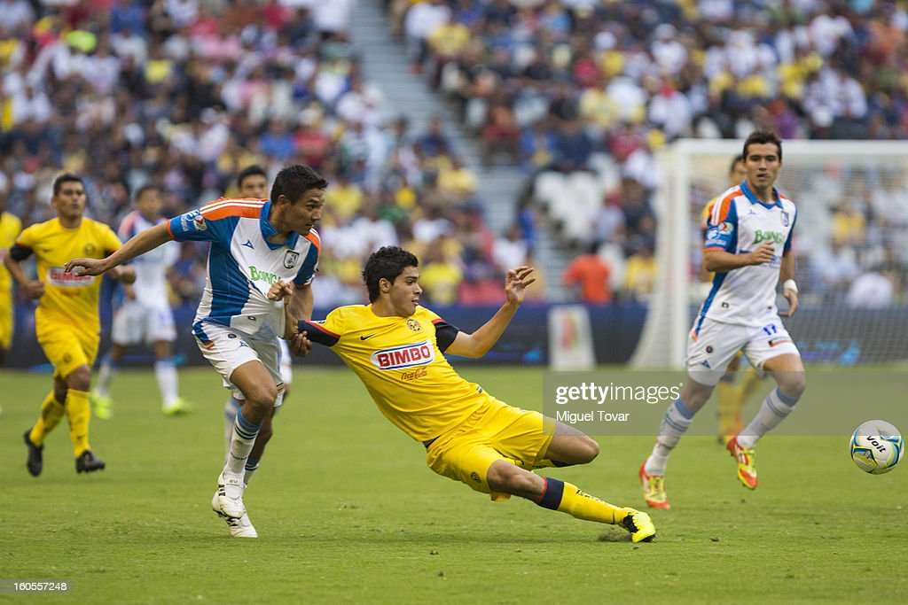 Raul Jimenez of America fights for the ball with Pablo Gabas of Queretaro during a Clausura 2013 Liga MX match at Azteca Stadium on February 02, 2013 in Mexico City, Mexico.