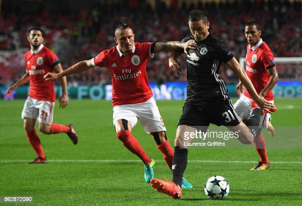 Raul Jimenez of Benfica and Nemanja Matic of Manchester United in action during the UEFA Champions League group A match between SL Benfica and...