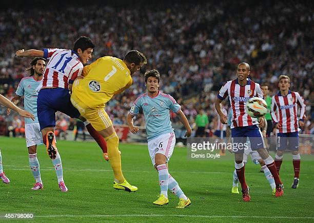 Raul Jimenez of Club Atletico de Madrid beats Sergio Alvarez of Real Club Celta de Vigo to put the ball in the net during the La Liga match at the...