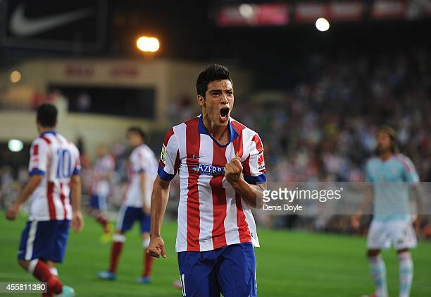 Raul Jimenez of Club Atletico de Madrid celebrates after beating Sergio Alvarez of Real Club Celta de Vigo to put the ball in the net during the La...